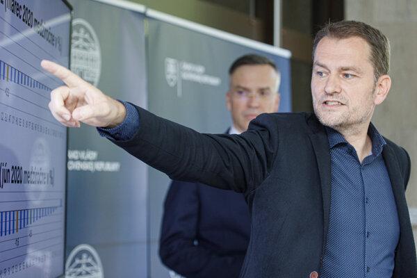 Štátny tajomník ministerstva financií Marcel Klimek a predseda vlády Igor Matovič (OĽaNO).