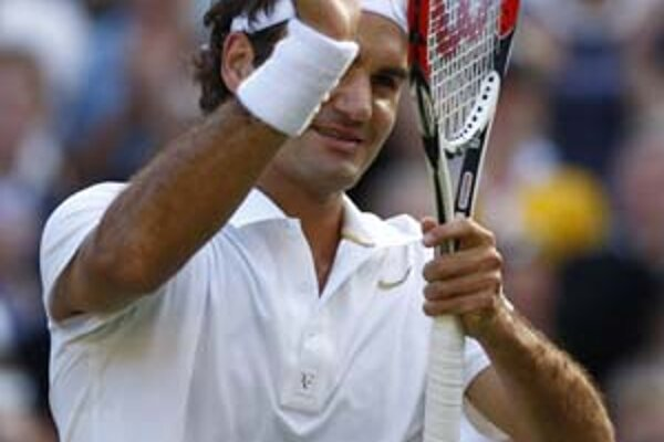 Roger Federer prehral vo Wimbledone naposledy s Mariom Ančičom  (dole) v sezóne 2002.