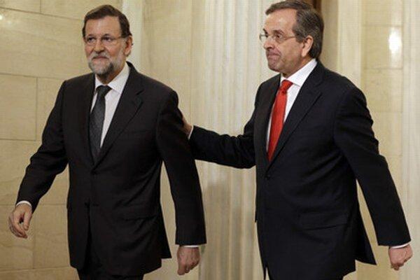Rajoy (vľavo).