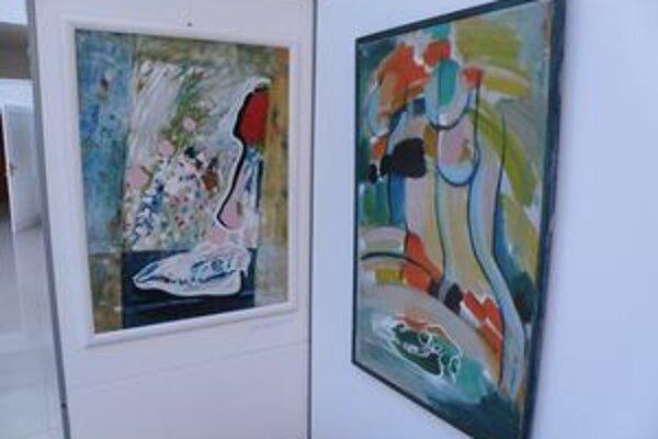 Obrazy spoločne vystavujú manželia Jelenákovci.