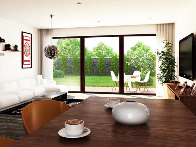 Priestranná obývacia miestnosť s  priamym prepojením na terasu, ktorá je krytá presahujúcou strechou. Presklená stena zabezpečí veľký prísun svetla, optické zväčšenie a spríjemnenie atmosféry v miestnosti