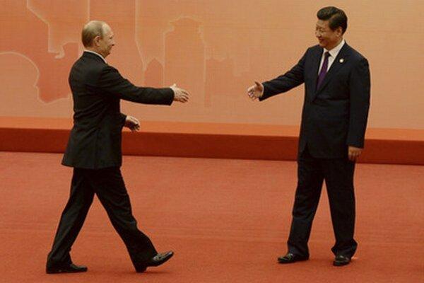 Putin dohaduje obchody s Čínou.