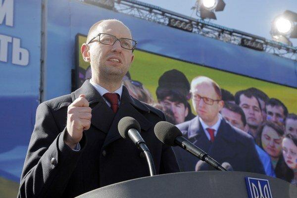 Premiér Arsenij Jaceňuk.
