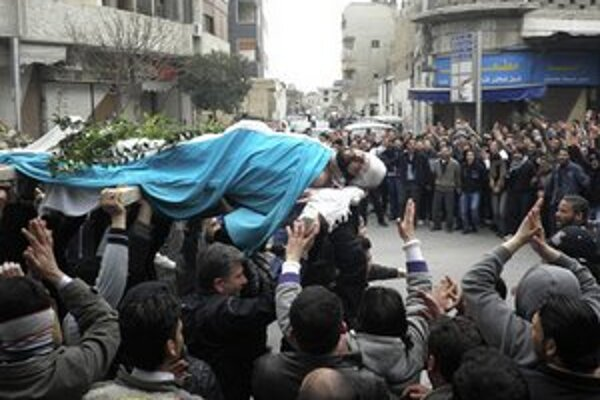 Pohreb zabitého demonštranta v Damasku.