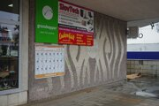 Mozaiku prekrýva reklama.