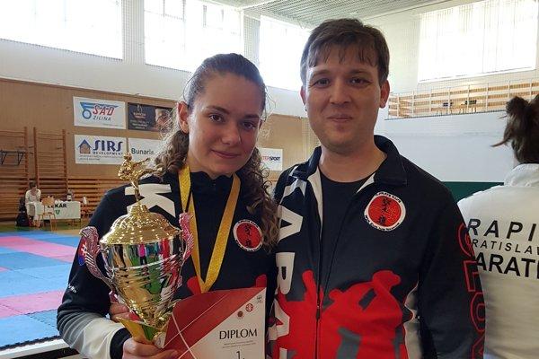Majsterka Slovenska Nina Jelžová so svojim trénerom.