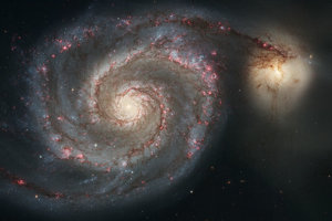 Galaxia M51 prezývaná aj Vírová galaxia.