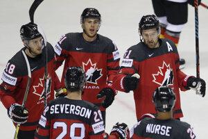 Kanadskí hráči sa radujú po jednom z gólov.