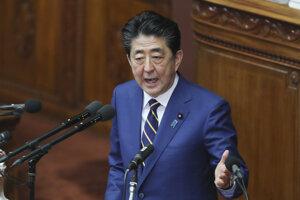 Predseda japonskej vlády Šinzó Abe.