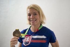 Ingrida Suchánková a bronzová medaila, archívna fotografia.