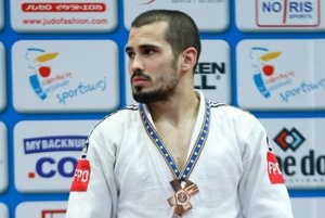 Matej Poliak s bronzovou medailou.