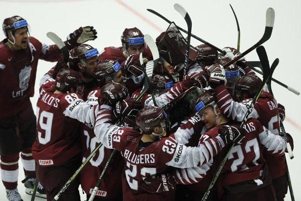 Hokejisti Lotyšska postúpili do štvrťfinále.