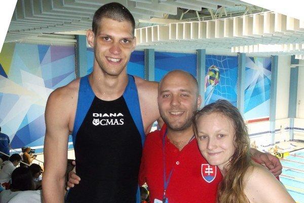 Námaha priniesla úspech. Tomáš Vandlík, Roman Kerak a Zuzana Christovová (zľava)na svetovom šampionáte v Kazani.