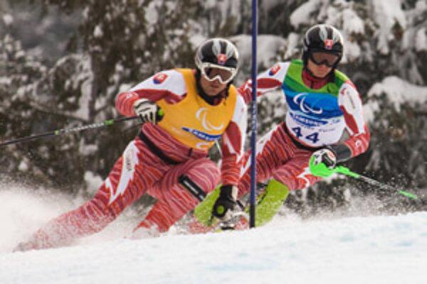 Vo Vancouvri trikrát zlatý. Jakub Krako (vpravo) s navádzačom J. Mederom.