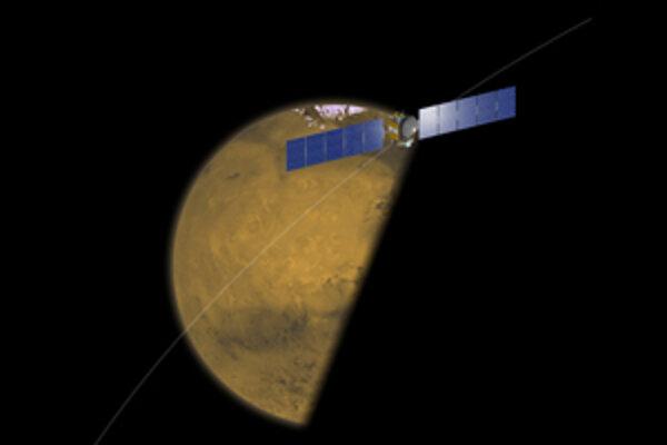 Sonda Dawn, ktorá mieri k asteroidu Vesta a trpasličej planéte Ceres, pri februárovom prelete okolo zatieneného Marsu v predstave umelca.