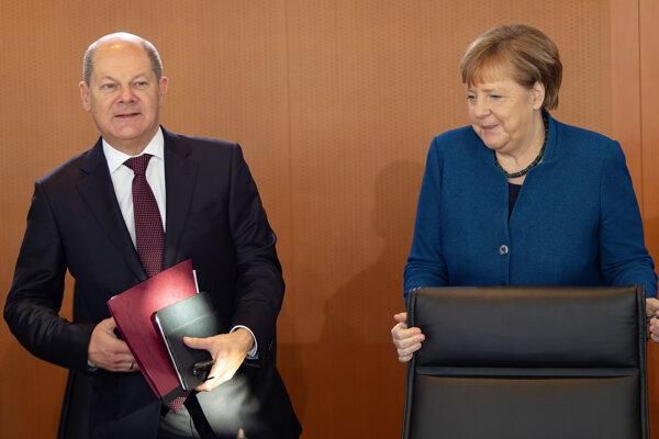 Nemecký minister financií Olaf Scholz a kancelárka Angela Merkelová.
