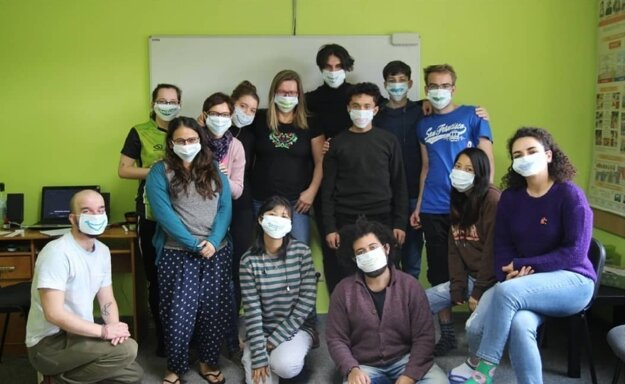 Volunteers wearing face-masks with