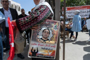 Palestínčania v Ramalláhu protestujú na podporu Izraelom väznených ľudí.