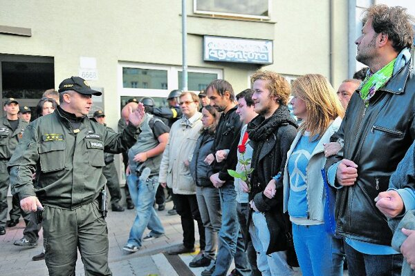 Several activists formed a humanchain to block anti–Roma marchers in Bratislava.