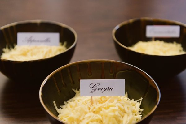 Three types of grated cheese for the fondue.
