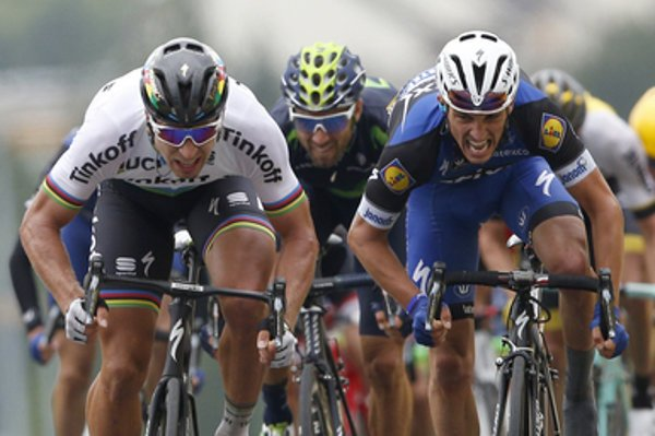 Peter Sagan of Slovakia (L) crosses the finish line ahead of France's Julian Alaphilippe (R) and Spain's Alejandro Valverde to win the second stage of the Tour de France cycling race Sunday, July 3, 2016.