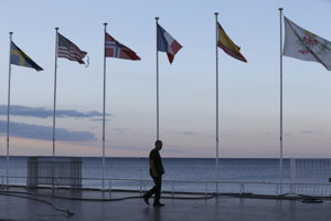 A security guard walks near the scene of an attack in the resort city of Nice, southern France.
