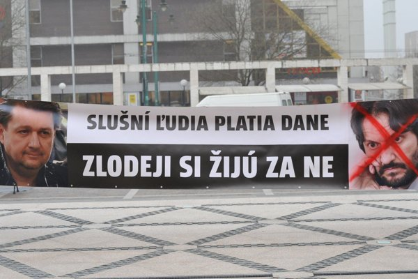 People protested at the Smer party congress December 10, 2016, holding a banner with businessman Ladislav Bašternák and Interior Minister Robert Kaliňák.