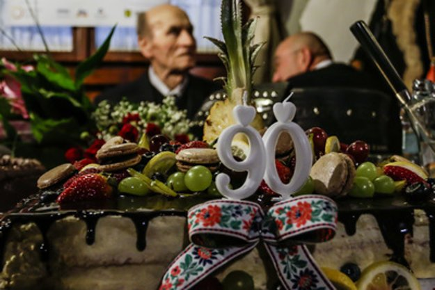 Štefan Nosáľ and his 90-th birthday cake.