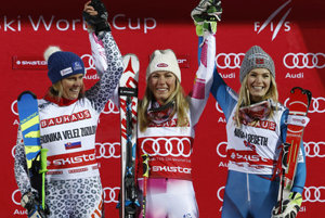 L-R: Second placed Veronika Velez-Zuzulová, the winner Mikaela Shiffrin, and third placed Nina Loeseth, celebrate on podium after an alpine ski, women's World Cup parallel slalom in Stockholm, January 31.