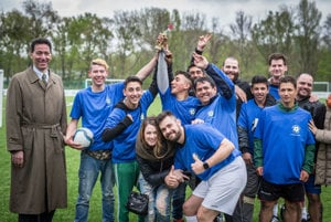 The winning team Sendrejovci - Plavecký štvrtok receives the trophy from US Ambassador Adam Sterling (L) during the Roma against diplomat tournament on April 8.
