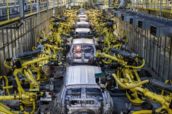 Robots assemble vehicles in the carmaker Kia Motors Slovakia.