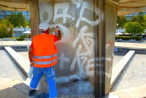 Cleaning the fountain at Námestie Slobody square of illegal graffiti.