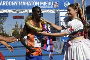 The marathon winner, Keiro of Kenya, gets a winner's wreath.