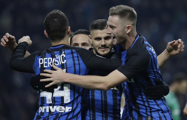 Inter Milan's Mauro Icardi celebrates with Milan Škriniar (R), and Ivan Perišič after scoring a goal during a Series A match between Inter Milan and Atalanta.