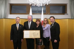 Head of State Opera Banská Bystrica Rudolf Hromada (2L) received the Japanese Foreign Minister's Award from Japanese Ambasssador to Slovakia (L) Jun Shimmi.