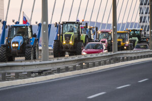 Tractors fill the Apollo Bridge, June 20.