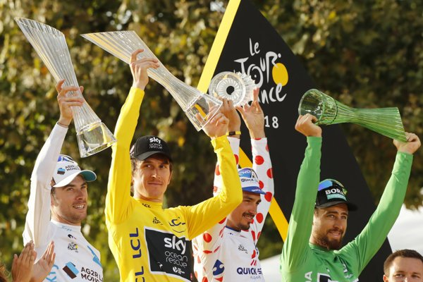 Winners of individual categories at Tour de France 2018, Sagan (R) in green jersey.