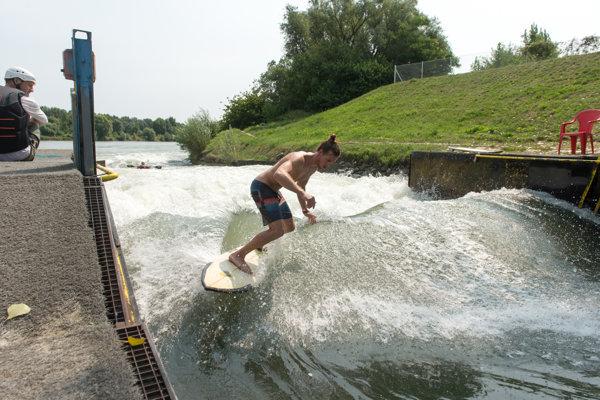 Surfing on the man-made wave in Divoká Voda resort in Čunovo.