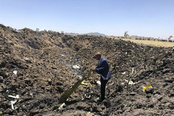 The CEO of Ethiopian Airlines, Tewolde Gebremariam, looks at the wreckage of the plane that crashed shortly after takeoff from Addis Ababa, Ethiopia, on March 10, 2019.