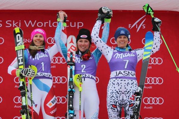 US Mikaela Shiffrin, center, winner of alpine ski World Cup women's slalom, celebrates with second placed Wendy Holdener, of Switzerland, left, and third placed Slovakia's Veronika Velez Zuzulová, in Jasná.