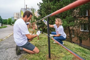 Some volunteers painted a railing in Hlohovec.