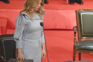 Zuzana Caputova swears the presidential oath into the hands of Constitutional Court President Ivan Fiacan.