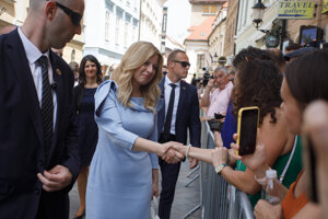 President Zuzana Čaputová greets citizens on her way from the Reduta building to the St. Martin Cathedral.