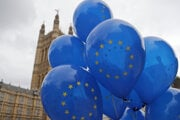 A Pro EU protestor holds balloons opposite parliament in London, on September 9, 2019. British Prime Minister Boris Johnson voiced optimism on the same day that a new Brexit deal can be reached so Britain leaves the European Union by October 31.