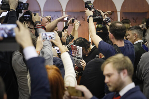 Alena Zsuzsová surrounded by journalists