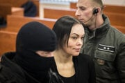 Alena Zsuzsová is escorted to the courtroom.
