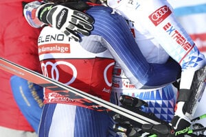 Slovakia's Petra Vlhová (r) hugs Italy's Federica Brignone at the finish area during an alpine ski, World Cup women's giant slalom in Sestriere, Italy.