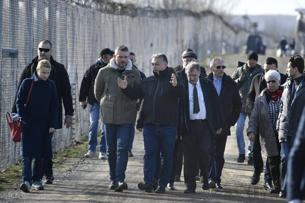 Hungarian PM Viktor Orbán (centre) and his Slovak counterpart Peter Pellegrini (centre-left) during their visit at the transit zone for migrants in Röszke on the Hungarian-Serbian border.