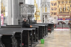 A woman disinfects benches in St. Elisabeth Cathedral in Košice on March 10, 2020.