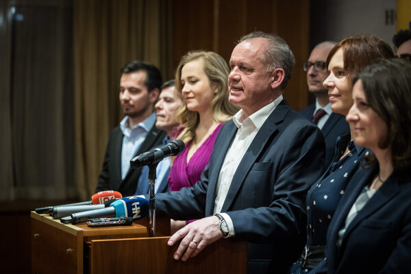 Andrej Kiska surrounded by his colleagues from the Za Ľudí party during the election night.